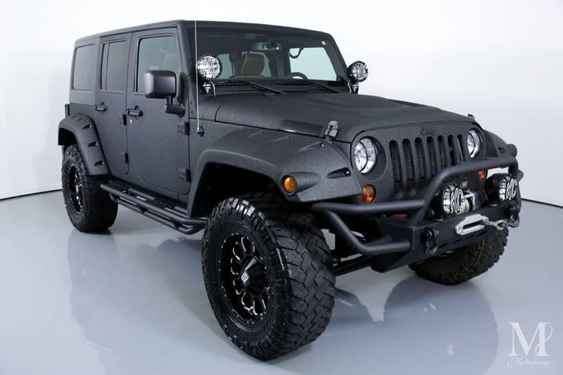 Used 2013 Jeep Wrangler Unlimited Sport 4x4 4dr SUV for sale Sold at Metrolina Auto Group in Charlotte NC 28217 - 2