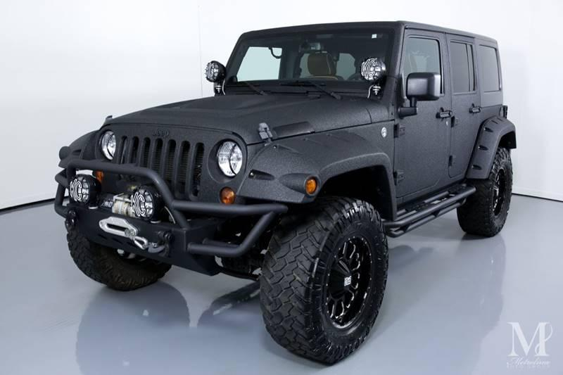 Used 2013 Jeep Wrangler Unlimited Sport 4x4 4dr SUV for sale Sold at Metrolina Auto Group in Charlotte NC 28217 - 4