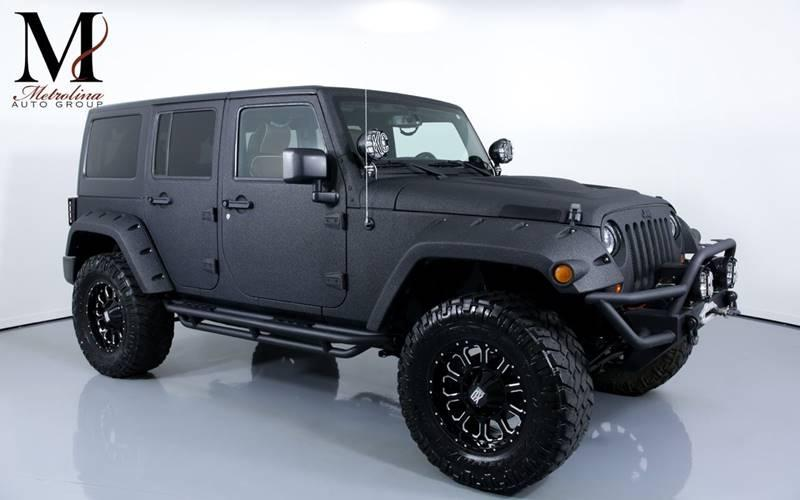 Used 2013 Jeep Wrangler Unlimited Sport 4x4 4dr SUV for sale Sold at Metrolina Auto Group in Charlotte NC 28217 - 1