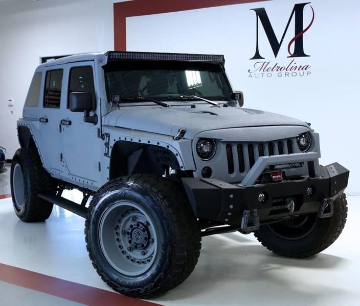 Used 2017 Jeep Wrangler Unlimited Rubicon 4x4 4dr SUV for sale Sold at Metrolina Auto Group in Charlotte NC 28217 - 3