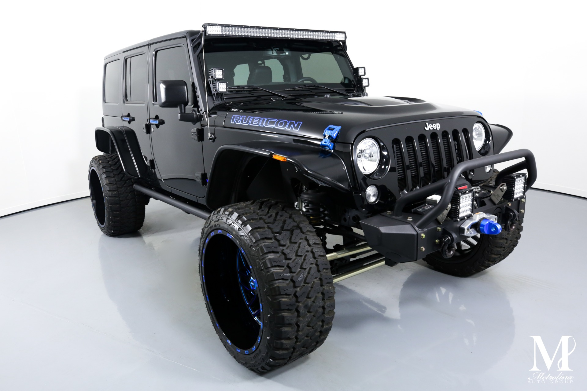 Used 2014 Jeep Wrangler Unlimited Rubicon for sale $47,996 at Metrolina Auto Group in Charlotte NC 28217 - 2