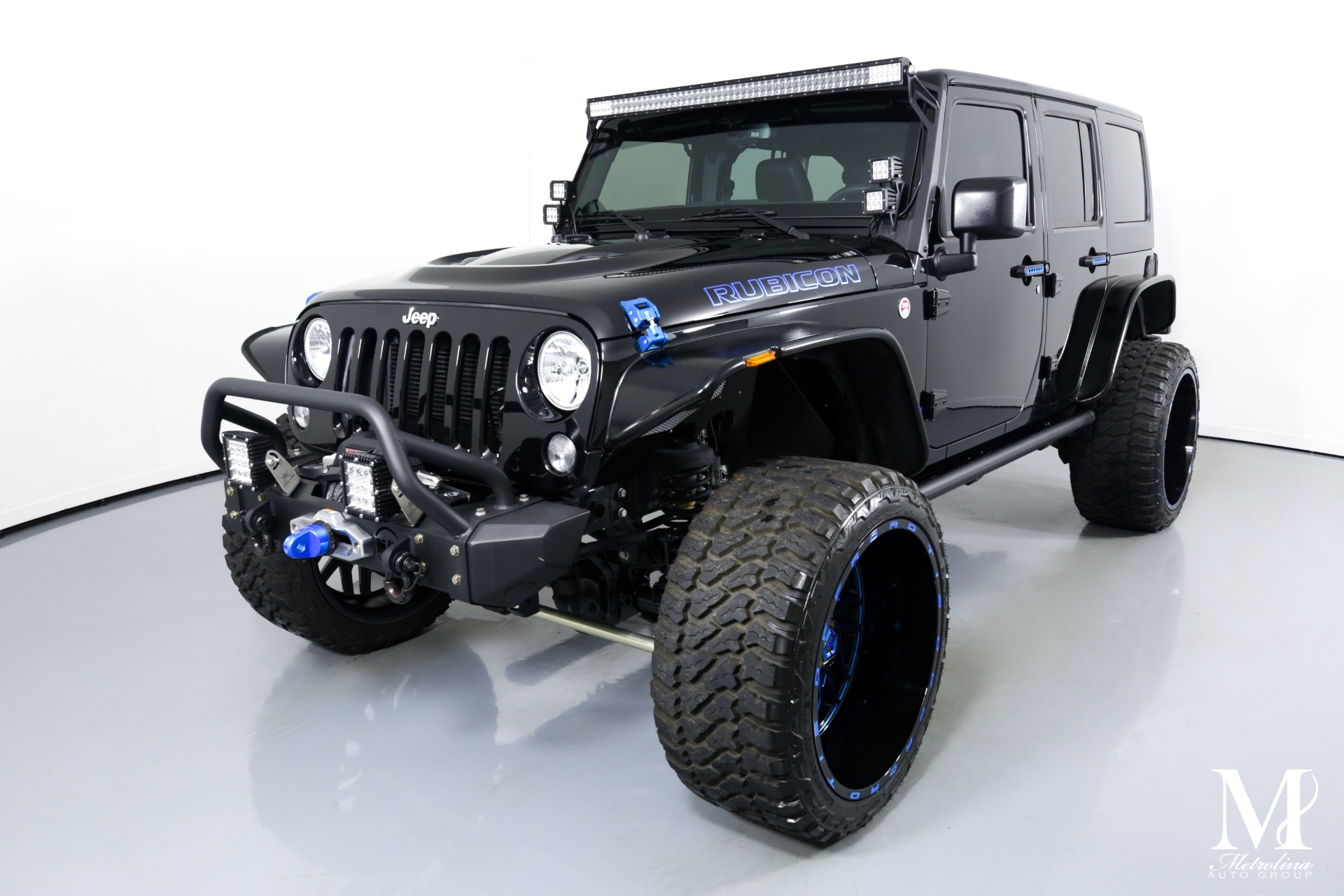 Used 2014 Jeep Wrangler Unlimited Rubicon for sale $47,996 at Metrolina Auto Group in Charlotte NC 28217 - 4