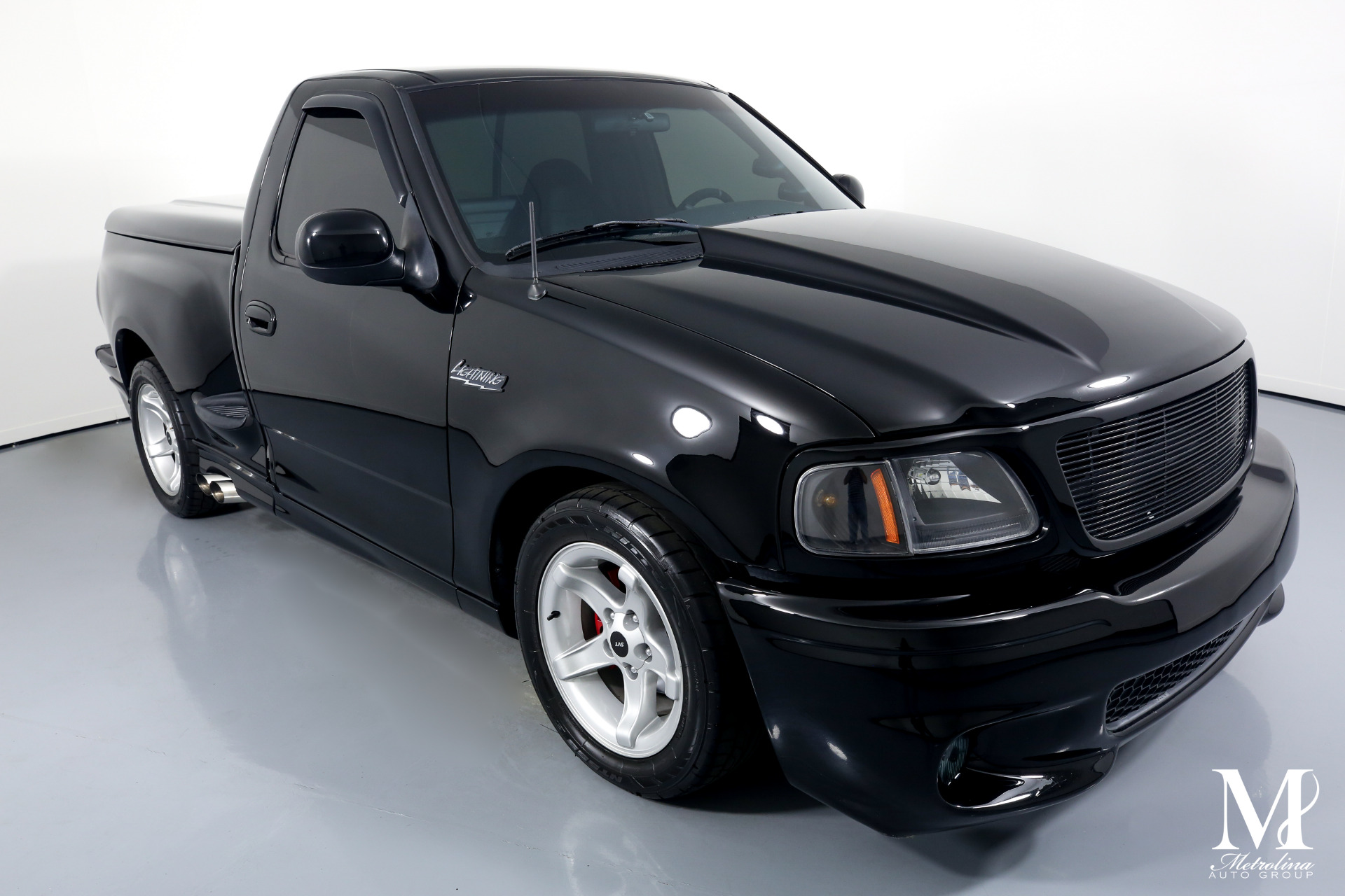 Used 2000 Ford F-150 SVT Lightning for sale $39,996 at Metrolina Auto Group in Charlotte NC 28217 - 2