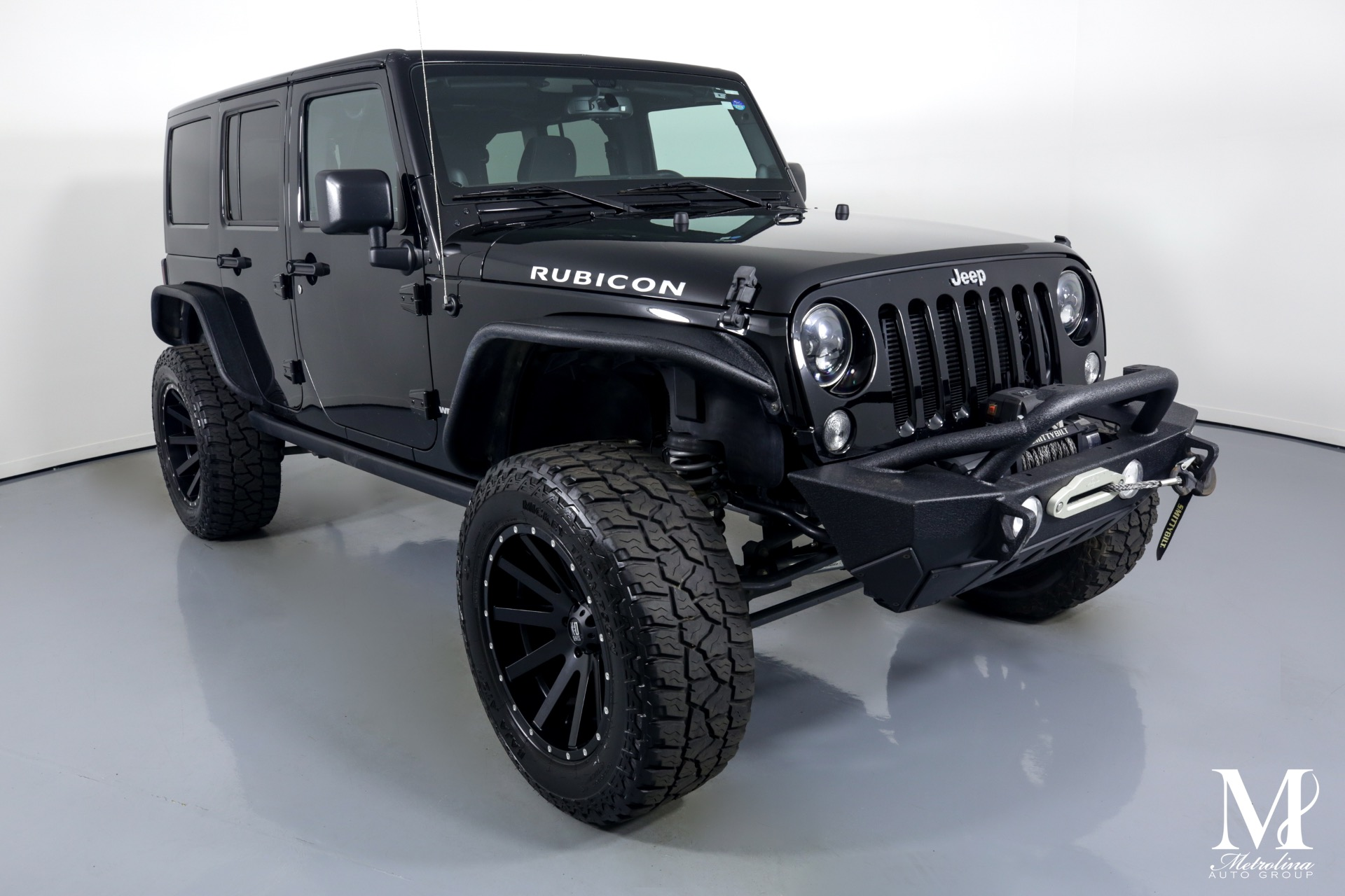 Used 2014 Jeep Wrangler Unlimited Rubicon for sale $44,996 at Metrolina Auto Group in Charlotte NC 28217 - 2