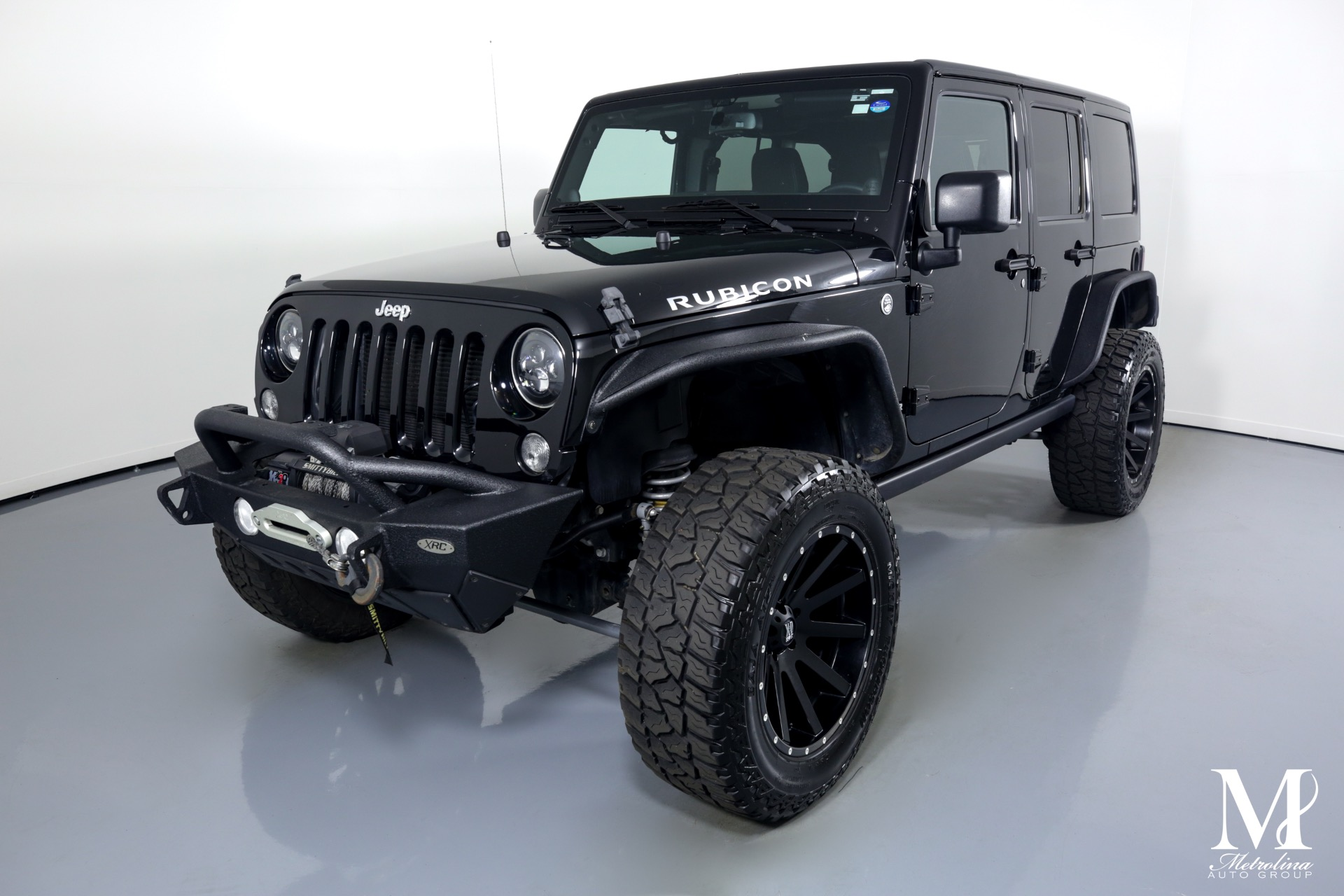 Used 2014 Jeep Wrangler Unlimited Rubicon for sale $44,996 at Metrolina Auto Group in Charlotte NC 28217 - 4
