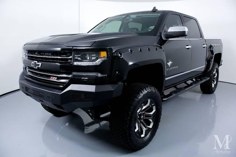 Used 2018 Chevrolet Silverado 1500 LTZ 4x4 4dr Crew Cab 5.8 ft. SB for sale Sold at Metrolina Auto Group in Charlotte NC 28217 - 4