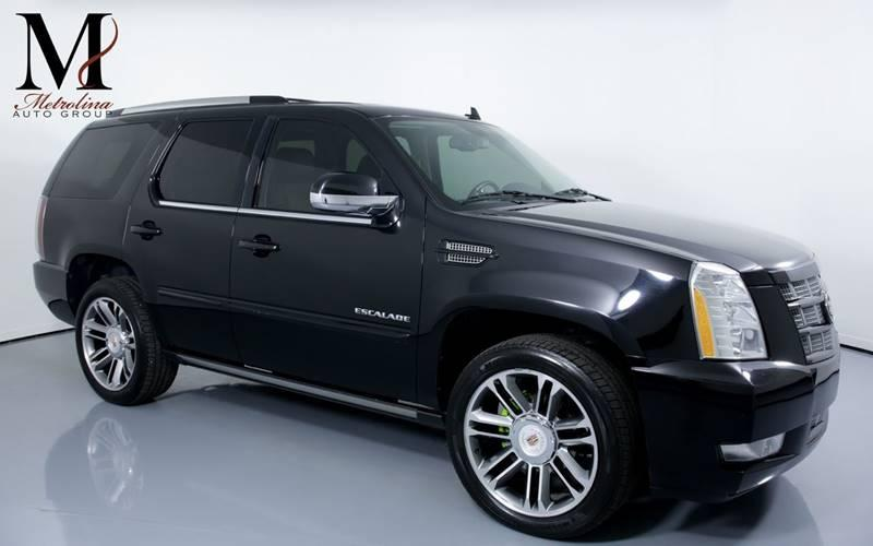 Used 2012 Cadillac Escalade Premium AWD 4dr SUV for sale Sold at Metrolina Auto Group in Charlotte NC 28217 - 1