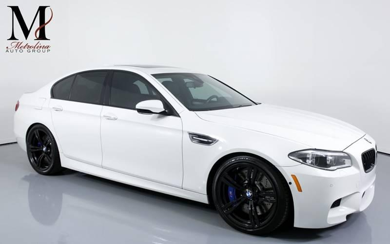 Used 2015 BMW M5 Base 4dr Sedan for sale Sold at Metrolina Auto Group in Charlotte NC 28217 - 1