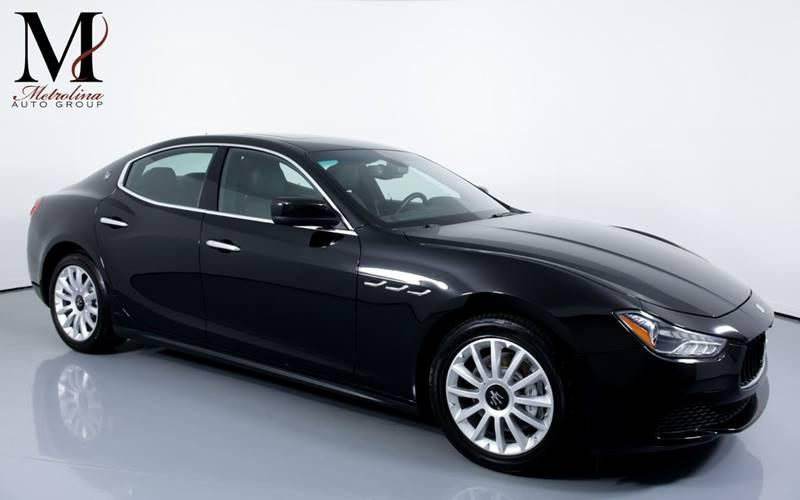 Used 2014 Maserati Ghibli Base 4dr Sedan for sale Sold at Metrolina Auto Group in Charlotte NC 28217 - 1